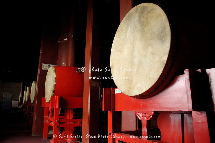 Drums lined up in a row inside a drum tower, Beijing, China.