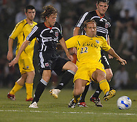 U.S. Open Cup Round of 16: Columbus Crew Sebastian Rozental (22) kicks the ball past DC United's Brian Carroll (16). DC United defeated the Columbus Crew in overtime 2-1, Tuesday, August 1, 2006, at Maryland Soccerplex.