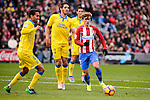 Atletico de Madrid Antoine Griezmann and UD Las Palmas Angel Montero, Pedro Bigas during La Liga match between Atletico de Madrid and UD Las Palmas at Vicente Calderon Stadium in Madrid, Spain. December 17, 2016. (ALTERPHOTOS/BorjaB.Hojas)