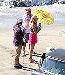 October 28th 2011 ...Courteney Cox filming the tv show Cougar Town in Malibu California. Co-stars  Busy Phillipps , Dan Byrd & Brian Van Holt were also on set. They added Sarah Chalke to a scene having a romantic beach date. Sarah was wearing a bikini under her dress & showing off her long legs. Courteney Cox was also wearing a bikini under her see through white shirt & eating lunch in between filming . ...AbilityFilms@yahoo.com.805-427-3519.www.AbilityFilms.com..