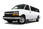 Stock pictures of low aggressive front three quarter view of 2016 Chevrolet Express 3500-LS 4 Door Passenger Van Low Aggressive
