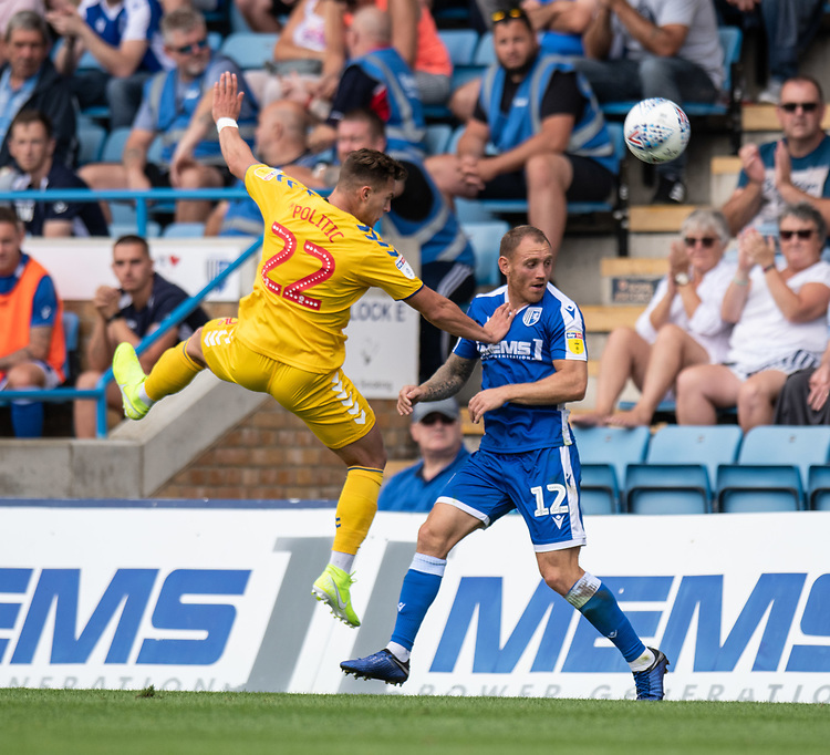 Bolton Wanderers' Dennis Politic (left) battles with Gillingham's Barry Fuller (right) <br /> <br /> Photographer David Horton/CameraSport<br /> <br /> The EFL Sky Bet League One - Gillingham v Bolton Wanderers - Saturday 31st August 2019 - Priestfield Stadium - Gillingham<br /> <br /> World Copyright © 2019 CameraSport. All rights reserved. 43 Linden Ave. Countesthorpe. Leicester. England. LE8 5PG - Tel: +44 (0) 116 277 4147 - admin@camerasport.com - www.camerasport.com