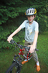 Nine year old boy on his mountain bike.