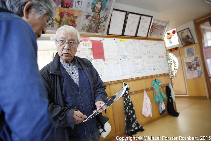 Nuclear scientist Ikuro Anzai and his dosimetry team measure radiation levels near Torikawa Nursery School in Fukushima City, and then report their findings to school director Miyoko Sato. Full caption to come.<br /> <br /> &copy; Michael Forster Rothbart Photography<br /> www.mfrphoto.com &bull; 607-267-4893<br /> 34 Spruce St, Oneonta, NY 13820<br /> 86 Three Mile Pond Rd, Vassalboro, ME 04989<br /> info@mfrphoto.com<br /> Photo by: Michael Forster Rothbart<br /> Date:  9/25/2015<br /> File#:  Canon &mdash; Canon EOS 5D Mark III digital camera frame A15715