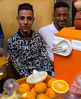 Fes, Morocco.  Two Young Men Selling Orange Juice in the Medina.
