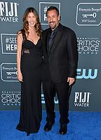 SANTA MONICA, USA. January 12, 2020: Adam Sandler & Jackie Sandler at the 25th Annual Critics' Choice Awards at the Barker Hangar, Santa Monica.<br /> Picture: Paul Smith/Featureflash