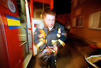 Firefighter in breathing apparatus running towards the front door of a house on fire. This image may only be used to portray the subject in a positive manner..©shoutpictures.com..john@shoutpictures.com