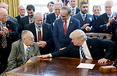 United States President Donald Trump meets with thirty Medal of Honor recipients in the Oval Office of  the White House on March 24, 2017 in Washington, DC.  The thirty recipients are about 1/3 of the total living persons who have received the medal.<br /> Credit: Olivier Douliery / Pool via CNP