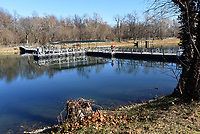 NWA Democrat-Gazette/FLIP PUTTHOFF <br /> A fishing dock spans the width of Lake Springdale      Dec. 22 2018, which is a haven for wintertime trout fishing.