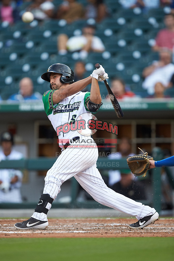 Seby Zavala (5) of the Caballeros de Charlotte follows through on his swing against the Buffalo Bisons at BB&T BallPark on July 23, 2019 in Charlotte, North Carolina. The Bisons defeated the Caballeros 8-1. (Brian Westerholt/Four Seam Images)