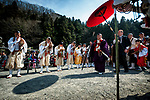The crowd watches as a Buddhist priest enters the ceremonial area during the Fire-walking Festival (Hiwatari-sai) at Mt. Takao on Sunday, March 12, 2017 in Hachioji, Japan.<br /> Photo by Kevin Clifford