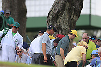 Bryson DeChambeau (USA)looking for his ball in the crowd on 7 during the 2nd round at the The Masters , Augusta National, Augusta, Georgia, USA. 12/04/2019.<br /> Picture Fran Caffrey / Golffile.ie<br /> <br /> All photo usage must carry mandatory copyright credit (© Golffile | Fran Caffrey)