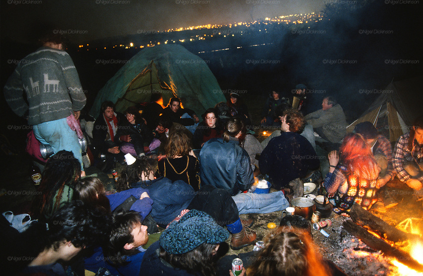 Camped up on the dongas. Road Protest actions at Twyford Down, near the Donga pathways, outside Winchester, against the M3 road extension. 1992-94<br /><br />The British Road Protesters movement began in the early 1990s when the Donga tribe squatted Twyford Down to save this beautiful site, a site of scientific interest SSI from the Ministry of transport's road building programme which threatened to destroy the landscape. The Dongas was the name of the ancient walkways, the paths trodden in the middle ages by people walking down to Winchester. A small tribe were joined by people of all walks of life who came to Twyford Down to defend it. A long hard battle over several years ended in the 'cutting' a new motorway built through this ancient monument and destroying it. <br /><br />The Road Protest movement in Britain continued for many years and more battles were fought in London against the MII both at Wanstead then in Leytonstone, and subsequently at Newbury, and in Sussex. the protesters were very inventive in their use of non violent peaceful direct action. They barricaded themselves into squats, made tree houses, tunnels and have huge demonstrations against the bailliffs, police and security who tried to force their way through the defences of this alternative environmental popular movement. Many of the roads were built eventually and many sites of great beauty lost, but the government had to stand down from its road building policy and eventually the programme was halted. the protests cost the government billions. Out of that movement grew many environmental NGOs who have to this day kept fighting for ecological and sustainable environmental solutions rather than following the cult of the car, petrol and roadbuilding..