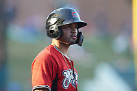 Mario Feliciano (4) of the Carolina Mudcats waits for his turn to bat during the game against the Winston-Salem Dash at BB&T Ballpark on June 1, 2019 in Winston-Salem, North Carolina. The Mudcats defeated the Dash 6-3 in game one of a double header. (Brian Westerholt/Four Seam Images)