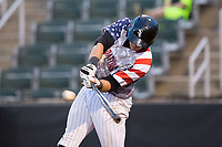 Brandon Dulin (31) of the Kannapolis Intimidators makes contact with the baseball against the Hickory Crawdads in game two of a double-header at Kannapolis Intimidators Stadium on May 19, 2017 in Kannapolis, North Carolina.  The Intimidators defeated the Crawdads 9-1.  (Brian Westerholt/Four Seam Images)