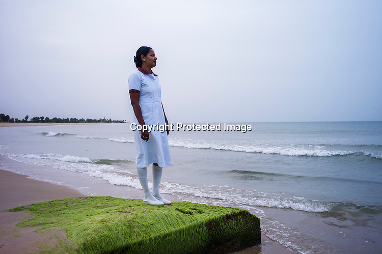 Mathumita poses for a portrait on the beach where the last battle took place between the LTTE and the Sri Lankan army took place in Vellamullivaikal in Kilinochchi in Northern Sri Lanka. Photo: Sanjit Das/Panos