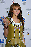 UNIVERSAL CITY, CA. - September 14: Actress/Singer Miley Cyrus arrives at The City of Hope Benefit Concert at Gibson Amphitheater on September 14, 2008 in Universal City, California.
