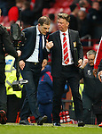 West Ham manager, Slaven Bilic and Louis Van Gaal, manager of Manchester United speak at full time during the Emirates FA Cup match at Old Trafford. Photo credit should read: Philip Oldham/Sportimage