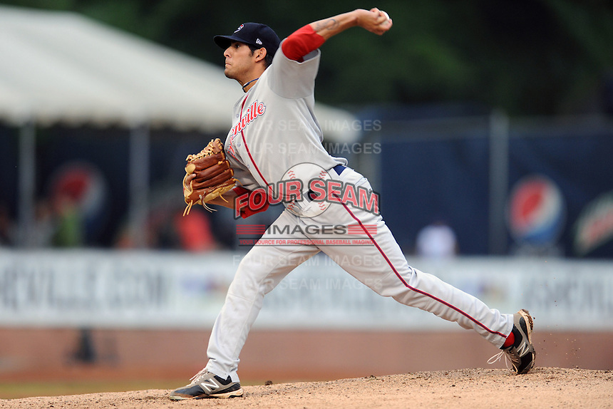 Greenville Drive starting pitcher Miguel Pena #5 delivers a pitch during  a game against the Asheville Tourists at McCormick Field on August 18, 2012 in Asheville, North Carolina. The Tourists defeated the Drive 12-2 (Tony Farlow/Four Seam Images).