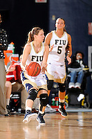 21 January 2012:  FIU guard Zsofia Labady (3) handles the ball in the first half as the Florida Atlantic University Owls defeated the FIU Golden Panthers, 50-49, at the U.S. Century Bank Arena in Miami, Florida.
