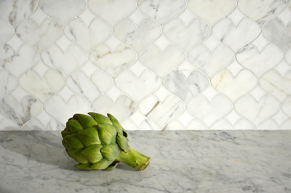 Hearts, a natural stone waterjet mosaic shown in polished Calacatta Tia and Thassos, is part of the Erin Adams Collection for New Ravenna.