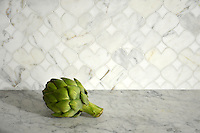 Hearts, a natural stone waterjet mosaic shown in polished Calacatta Tia and Thassos, is part of the Erin Adams Collection for New Ravenna Mosaics.<br />