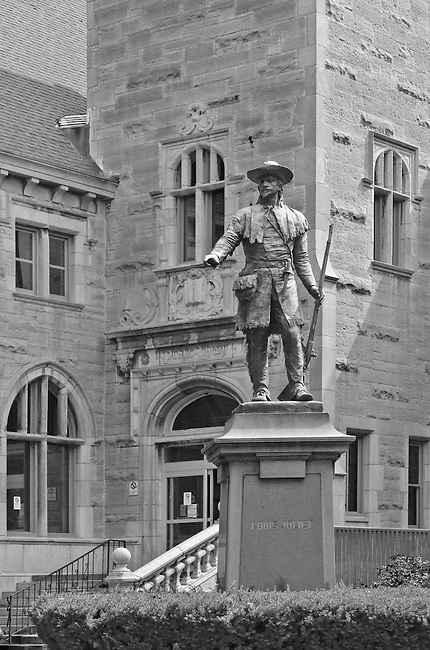 A statue of the famed explorer and Joliet namesake, Louis Joliet guards the entrance to the Joliet Public Library Main Branch