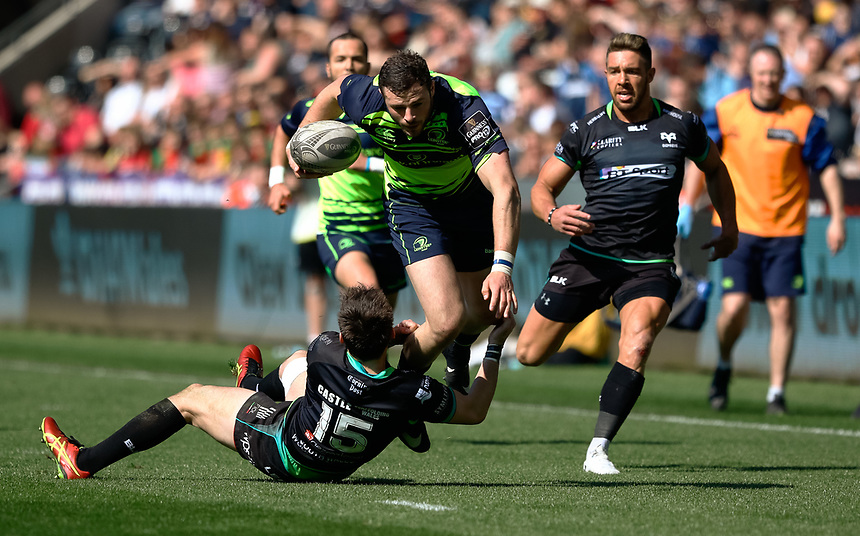 Leinster's Robbie Henshaw is tackled by Ospreys' Sam Davies<br /> <br /> Photographer Simon King/CameraSport<br /> <br /> Guinness PRO12 Round 19 - Ospreys v Leinster Rugby - Saturday 8th April 2017 - Liberty Stadium - Swansea<br /> <br /> World Copyright &copy; 2017 CameraSport. All rights reserved. 43 Linden Ave. Countesthorpe. Leicester. England. LE8 5PG - Tel: +44 (0) 116 277 4147 - admin@camerasport.com - www.camerasport.com