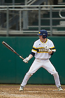 Michigan Wolverines third baseman Jacob Cronenworth (2) at bat during the NCAA baseball game against the Washington Huskies on February 16, 2014 at Bobcat Ballpark in San Marcos, Texas. The game went eight innings, before travel curfew ended the contest in a 7-7 tie. (Andrew Woolley/Four Seam Images)
