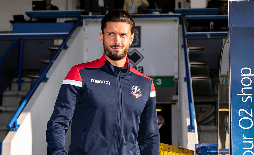 Bolton Wanderers' Jason Lowe goes out to inspect the pitch before the match<br /> <br /> Photographer Andrew Kearns/CameraSport<br /> <br /> The Carabao Cup First Round - Rochdale v Bolton Wanderers - Tuesday 13th August 2019 - Spotland Stadium - Rochdale<br />  <br /> World Copyright © 2019 CameraSport. All rights reserved. 43 Linden Ave. Countesthorpe. Leicester. England. LE8 5PG - Tel: +44 (0) 116 277 4147 - admin@camerasport.com - www.camerasport.com