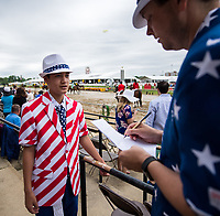 BALTIMORE, MD - MAY 20: Race fans dressed in a patriotic theme take notes before an undercard race on Preakness Stakes Day at Pimlico Race Course on May 20, 2017 in Baltimore, Maryland.(Photo by Scott Serio/Eclipse Sportswire/Getty Images)