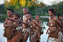 Botswana, Kalahari, bushman (san) mothers carrying their young children on their back
