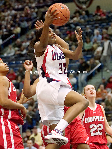 HARTFORD, CT. 05 March 2007-030507SV02--#32 Kalana Greene of UConn puts up a shot over #25 Michelle Poindexter of Louisville during Big East semifinal tournament action at the Hartford Civic Center in Hartford Monday.<br /> Steven Valenti Republican-American