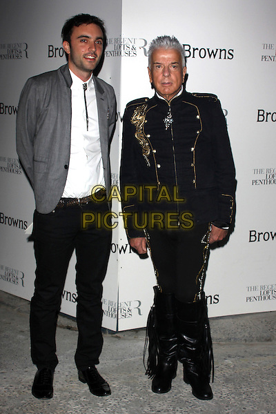 NICKY HASLAM .Attends the 40th anniversary celebrations of Browns fashion boutique, Marshall Street, London, England, UK, May 12th, 2010..arrivals full length black jacket military gold trousers boots tassels knee high epaulettes.CAP/AH.©Adam Houghton/Capital Pictures.