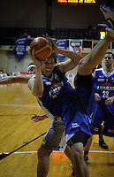 Saints forward Casey Frank tries to hold onto the ball underneath the basket during the NBL match between Wellington Saints and Bay Hawks at TSB Bank Arena, Wellington, New Zealand on Thursday, 13 May 2010. Photo: Dave Lintott / lintottphoto.co.nz