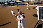 "Lawn bowlers play a game outside of the Bell Recreation Center in Sun City, Arizona December 8, 2010. The lawn bowling club is one of more than 120 clubs in the city of active retirees..""This is why we worked 50 years,"" lawn bowler Norm Dickson said after bowling his ball. ""...in the cold,"" his teammate Myron Myers chimed in...2010 marks the 50th anniversary of Sun City, America's first retirement city that remains the largest today with more than 40,000 residents 55 and older."