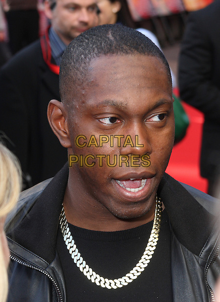 DIZZEE RASCAL (Dylan Kwabena Mills).UK Gala Film Premiere of 'The Karate Kid' at the Odeon Leicester Square, London, England, UK, July 15th 2010.portrait headshot chain necklace black mouth open .CAP/JIL.©Jill Mayhew/Capital Pictures