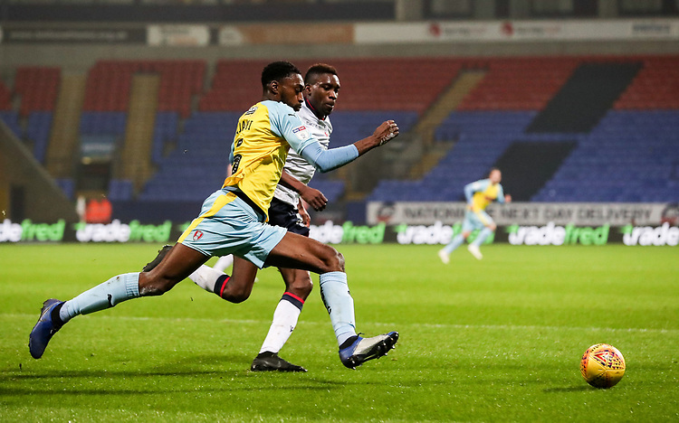 Bolton Wanderers' Sammy Ameobi competing with Rotherham United's Semi Ajayi<br /> <br /> Photographer Andrew Kearns/CameraSport<br /> <br /> The EFL Sky Bet Championship - Bolton Wanderers v Rotherham United - Wednesday 26th December 2018 - University of Bolton Stadium - Bolton<br /> <br /> World Copyright © 2018 CameraSport. All rights reserved. 43 Linden Ave. Countesthorpe. Leicester. England. LE8 5PG - Tel: +44 (0) 116 277 4147 - admin@camerasport.com - www.camerasport.com