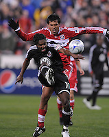 DC United forward Luciano Emilio (11) battles for the ball against Chicago Fire defender Wilma Conde (22). Chicago Fire tied DC United 1-1 at RFK Stadium, Saturday March 28, 2009.