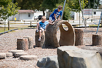 NWA Democrat-Gazette/CHARLIE KAIJO Gavin Lambert, 3 and Phoenix Lambert, 5 of Bella Vista play at the park at Centerton City Hall in Centerton, AR on Friday, September 7, 2017. Centerton residents will decide Tuesday if they want to extend a one-cent sales tax to pay for road improvements, park development and a new city hall.