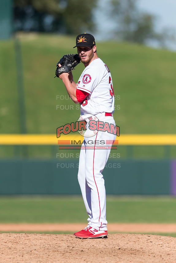 Mesa Solar Sox relief pitcher Ryan Clark (38), of the Los Angeles Angels organization, gets ready to deliver a pitch during an Arizona Fall League game against the Salt River Rafters at Sloan Park on October 30, 2018 in Mesa, Arizona. Salt River defeated Mesa 14-4 . (Zachary Lucy/Four Seam Images)