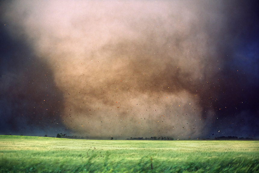 Debris flies as a large destructive tornado strikes Manchester South Dakota on June 24th, 2003. The town was totally destroyed and never rebuilt. This storm was part of the largest single-day outbreak of tornadoes in South Dakota history.