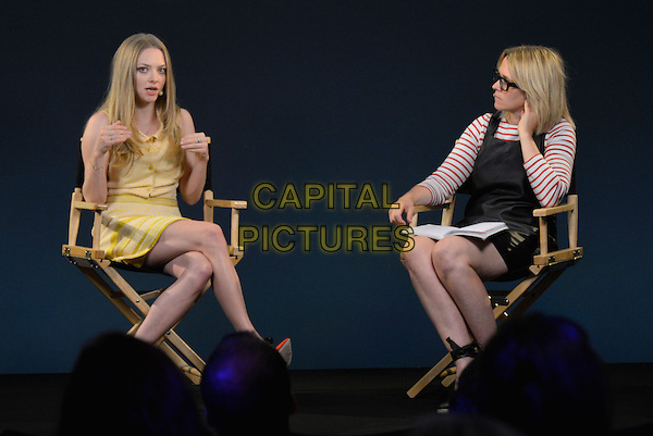 Amanda Seyfried with Edith Bowman<br /> 'Meet The Actor' event at Apple Store, Regent Street, London, England.<br /> 13th August 2013<br /> full length sitting chair yellow dress pinafore red white stripe top glasses profile hands arms<br /> CAP/PL<br /> &copy;Phil Loftus/Capital Pictures