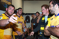 Reggie Goodes and Jeff Toomaga-Allen meet Prince Harry in the changing rooms after the Super Rugby match between the Hurricanes and Sharks at Westpac Stadium, Wellington, New Zealand on Saturday, 9 May 2015. Photo: Dave Lintott / lintottphoto.co.nz