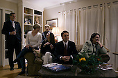 Columbia, South Carolina.USA.February 3, 2004..Senator John Edwards and his wife Elizabeth (right) an daughter Kate (21 - left of her father)) watch the election returns at a f=close friends house..