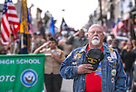 Frank Reynolds, with Carson Area Chapter 388 Vietnam Veterans of America, stands at attention during the annual Veteran's Day Parade in Virginia City, Nev., on Tuesday, Nov. 11, 2014.<br />