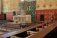 Chapel, with altar and wall paintings with the motto of Nicolas Rolin, Seulle and a star, in the Salle des Povres or Room of the Poor, almost 50m long, with a painted wooden ceiling with dragons' heads and caricatures of local people, in Les Hospices de Beaune, or Hotel-Dieu de Beaune, a charitable almshouse and hospital for the poor, built 1443-57 by Flemish architect Jacques Wiscrer, and founded by Nicolas Rolin, chancellor of Burgundy, and his wife Guigone de Salins, in Beaune, Cote d'Or, Burgundy, France. The hospital was run by the nuns of the order of Les Soeurs Hospitalieres de Beaune, and remained a hospital until the 1970s. The building now houses the Musee de l'Histoire de la Medecine, or Museum of the History of Medicine, and is listed as a historic monument. Picture by Manuel Cohen
