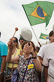 A woman bangs her pan in protest against Dilma Rousseff with a Brazilian flag behind her. Rio de Janeiro, Brazil, 15th March 2015. Popular demonstration against the President, Dilma Rousseff in Copacabana. Photo © Sue Cunningham sue@scphotographic.com.