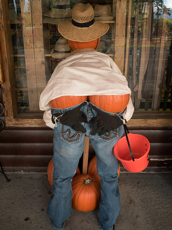 Halloween figure dressed up with a pumpking rear end. Utah