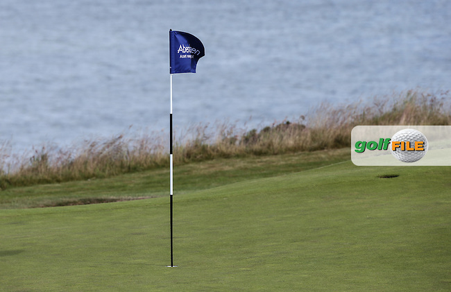 Wind blown pin flag during the First Round of the 2016 Aberdeen Asset Management Scottish Open, played at Castle Stuart Golf Club, Inverness, Scotland. 07/07/2016. Picture: David Lloyd | Golffile.<br /> <br /> All photos usage must carry mandatory copyright credit (&copy; Golffile | David Lloyd)